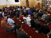 Muslims pray during a Friday prayer service at the Islamic Society of the Coachella Valley in Coachella.
