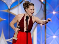 "Amy Adams accepts the award for best actress in a motion picture, musical or comedy for her role in ""American Hustle"" during the 71st annual Golden Globe Awards at the Beverly Hilton Hotel on Sunday. The film also won for best supporting actress, Jennifer Lawrence, and best picture, musical or comedy."