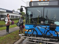 FLORIDA TODAY reporter Stacey Barchenger prepares to catch the No. 1 Space Coast Area Transit bus southbound at Wickham and Suntree Blvd.