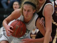 Ankeny Centennial forward Tasha Vipond gets the rebound while boxing out Ankeny defender Codee Myers during a high school girls basketball game between Ankeny Centennial and Ankeny on Friday night at Ankeny Centennial High School.
