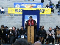 North Carolina NAACP President William Barber talks about fighting for social justice at the King Day rally on Monday, Jan. 20, 2014, in Columbia, S.C. Barber told the crowd of a few thousand people that what conservatives leaders have done to the country is mighty low, but he thinks they are ready to find higher ground. (AP Photo/Jeffrey Collins)