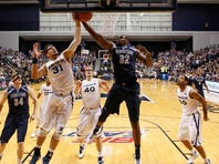 Xavier Musketeers forward Isaiah Philmore (31) goes up for the rebound during the second half against the Georgetown Hoyas center Moses Ayegba (32) at the Cintas Center. Frank Victores/USA Today Sports