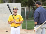 British Columbia Bomber Tommy Barksdale, who is almost completely deaf, watches manager Bart Zeller during batting practice at Palm Springs Stadium on Friday.
