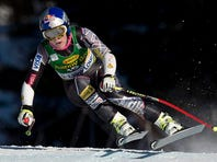 Lindsey Vonn races at the World Cup super-G in Alberta, Canada on Dec. 8. Vonn is going to skip the Sochi Olympics because of a right knee injury.