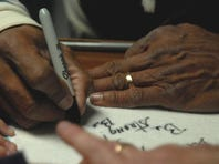 """Police officer and actor Erik Estrada, right, signs an autograph for Dustin Pike of Townsend at Full Gospel Church in Cheriton on Friday. Estrada was there to promote the film release of """"Uncommon,"""" which he stars in."""