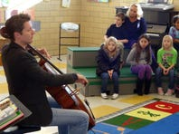 Dmitry Volkov played for third-graders at Ware Elementary School Thursday morning. Volkov is the artist-in-residence at the Heifetz International Music Institute at Mary Baldwin College.