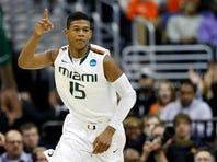 WASHINGTON, DC - MARCH 28:  Rion Brown #15 of the Miami (Fl) Hurricanes reacts against the Marquette Golden Eagles during the East Regional Round of the 2013 NCAA Men's Basketball Tournament at Verizon Center on March 28, 2013 in Washington, DC.  (Photo by Rob Carr/Getty Images)