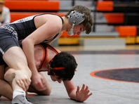 Ankeny Centennial senior Aaron Noce tries to turn Ames' Brycen Carney onto his back during a dual meet on Jan. 3 at Ames. On Saturday, Ankeny Centennial finished ninth at the Adel Invitational and Ames finished 11th.