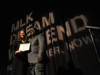 Leesa Owens, left, gives a certificate to David Wilson of Southside High School, who received a scholarship during the MLK Dream Weekend Diversity Lunch at the TD Convention Center on Monday, January 20, 2014.