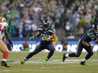 Jan 19, 2014; Seattle, WA, USA; Seattle Seahawks running back Marshawn Lynch (24) carries the ball against the San Francisco 49ers during the 2013 NFC Championship football game at CenturyLink Field. Seattle defeated San Francisco 23-17. Mandatory Credit: Steven Bisig-USA TODAY Sports