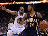 January 20, 2014; Oakland, CA, USA; Indiana Pacers small forward Paul George (24) dribbles the ball against Golden State Warriors small forward Andre Iguodala (9) during the fourth quarter at Oracle Arena. The Pacers defeated the Warriors 102-94. Mandatory Credit: Kyle Terada-USA TODAY Sports