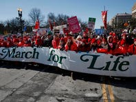 Anti-abortion demonstrators march up Constitution Avenue toward the Supreme Court in Washington, Wednesday during the annual March for Life. Thousands of anti-abortion demonstrators are gathering in Washington for an annual march to protest the Supreme Court's landmark 1973 decision that declared a constitutional right to abortion.