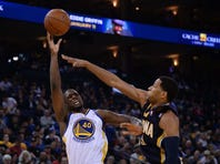 January 20, 2014; Oakland, CA, USA; Golden State Warriors small forward Harrison Barnes (40, left) shoots the ball against Indiana Pacers small forward Danny Granger (33) during the second quarter at Oracle Arena. Mandatory Credit: Kyle Terada-USA TODAY Sports