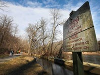 Residents walk and jog in Brandywine Park near the Wilmington intake system on Sunday.