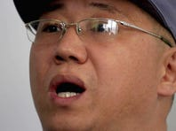 American missionary Kenneth Bae speaks to reporters at Pyongyang Friendship Hospital in Pyongyang on Monday. Bae, 45, who has been jailed in North Korea for more than a year, appealed for the U.S. to do its best to secure his release.