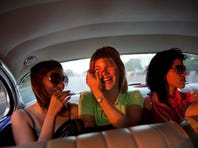 Amalia Reigosa Blanco, center, accompanied by her sisters Jaynet, left, and Anabel, right, travel to the Jose Marti International Airport in Havana, Cuba.