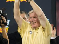 UCF head football coach George O'Leary holds up the Fiesta Bowl trophy following the Knights' 52-42 victory against Baylor in the Tostitos Fiesta Bowl.