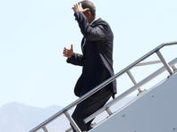 Gov. Jerry Brown tries to stay cool on the tarmac at the Palm Springs International Airport while he waits for President Obama to arrive on Friday, June 7, 2013.