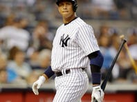 In this Aug. 20, 2013 photo, New York Yankees Alex Rodriguez reacts after striking out at Yankee Stadium in New York. Rodriguez's drug suspension has been cut to 162 games from 211 by arbitrator Fredric Horowitz, a decision sidelining the New York Yankees third baseman the entire 2014 season.