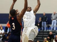 Siegel's Charles Clark goes up to dunk against Blackman's Jauan Jennings in the second half at Siegel on Dec. 10. The teams play again on Tuesday.