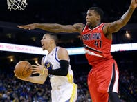 Golden State Warriors' Stephen Curry (30) drives past Portland Trail Blazers' Thomas Robinson (41) during the second half of an NBA basketball game on Sunday, Jan. 26, 2014, in Oakland, Calif. Golden State won 103-88. (AP Photo/Marcio Jose Sanchez)