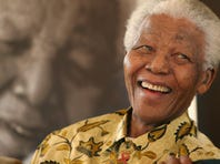 South African President Nelson Mandela, 87, smiles the Mandela Foundation in Johannesburg in 2005. On Thursday, Dec. 5, 2013, Mandela died at the age of 95. (AP Photo/Denis Farrell, File)
