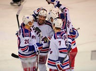 Greenville Road Warriors celebrate a second period goal against the Elmira Jackals earlier this season.