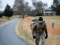 ADVANCE FOR RELEASE SUNDAY, DECEMBER 22, 2013 Scott Keel (left) and Ryan Adams rest at the end of their second day of walking on Red House Road near Rustburg, Va., December 16, 2013. (AP Photo/The News & Advance, Parker Michels-Boyce)