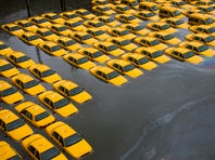 A parking lot full of yellow cabs in Hoboken is flooded as a result of Superstorm Sandy in October 2012.