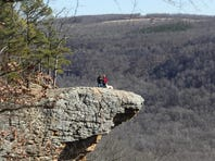 Hikers are pictured on Hawksbill Crag.