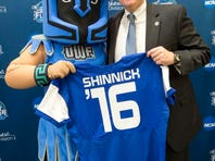 Argie, the University of West Florida mascot, welcomes new football coach Pete Shinnick to the UWF team during a press conference Thursday morning.