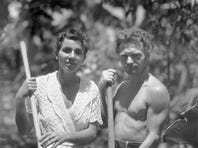 Dore Strauch and Friedrich Ritter holding tools on Floreana Island, Galapagos, circa 1932