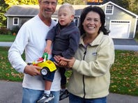 Doug and Cynthia Sharpe with their son, Jack.