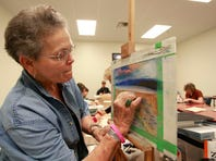 Darlene Bengsch draws a landscape scene from a photo using pastels during an art class this month at Hobby Lobby.