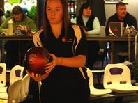 McAuley senior Lexi Baker preps to roll a practice shot before a match against St. Ursula Dec. 12 at Colerain Bowl. Baker is fourth in the city and second in the GGCL with a 198.1 average.