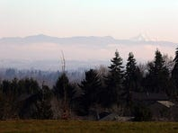 A haze blankets the Willamette Valley looking East toward the Cascade range from Straub Middle School in West Salem Monday.
