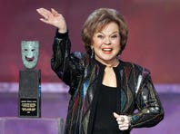 In this Jan. 29, 2006 file photo, Shirley Temple Black accepts the Screen Actors Guild Awards life achievement award at the 12th Annual Screen Actors Guild Awards, in Los Angeles. Shirley Temple, the curly-haired child star who put smiles on the faces of Depression-era moviegoers, has died. She was 85. (AP Photo/Mark J. Terrill, File)