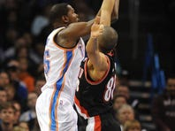 Oklahoma City's Kevin Durant (35) attempts a shot against Portland's Nicolas Batum (88).