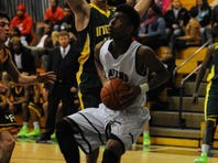 Sussex Tech forward Robert Larkin, right, drives to the basket against Indian River forward London Tucker last Friday at home.