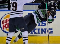 Greenville's Paul Arnott puts a big hit on Florida's Rocco Carzo Friday night at the Bon Secours Wellness Arena.