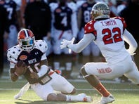 North quarterback Tajh Boyd (10), of Clemson, slides in front of the would-be tackle from South linebacker Telvin Smith (22), of Florida State, during the first half of the Senior Bowl on Saturday in Mobile, Ala.