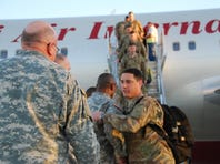 Members of the 189th General Support Aviation Battalion of the Montana National Guard return to the United States on Tuesday.