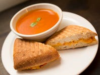 The menu at Flour. Sugar. Eggs. includes roasted tomato basil soup with grilled pimiento cheese panini.