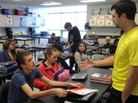Gerrad LaBue (right) talks with eighth-grader Chris Kirschman during a physical education class Thursday at Memorial Middle School Revised health curriculum in Sioux Falls public schools next year might include review of CPR for older students.
