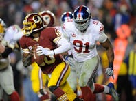 The last time the Giants' Justin Tuck, right, and Washington's Robert Griffin III met, Tuck had a career-high four sacks.