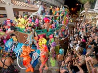 A float rolls down Duval Street in Key West during the Fantasy Fest Parade in this file photo. Key West city officials say they're going to take another look at nudity laws crafted for the annual Fantasy Fest.