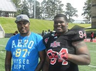 Arkansas State University football player Markel Owens, right, and his stepfather, Johnny Shivers, left, were shot to death in a home invasion robbery in Jackson on Wednesday night. / Photo submitted by family