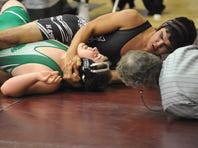 Harlem's Seth Adams, here attempting to pin Belgrade's Avery Whelan during CMR Holiday Classic a few years ago, is top-ranked among Class B-C 220-pounders. TRIBUNE FILE PHOTO/RION SANDERS