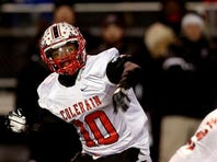 Colerain QB Kelvin Cook (10) throws a pass against Moeller in the in the Division I regional final football game Saturday November 23, 2013. The Enquirer/ Joseph Fuqua II