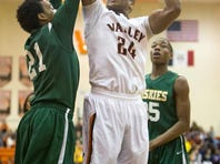 Valley's Dominique Dafney (24) shoots over Chris King (21) of visiting Hoover Friday at Valley in CIML boys' basketball play. King led all scorers with 21 points, with 11 of his points coming at the free-throw line. Dafney scored five points. Valley won in overtime, 70-68.